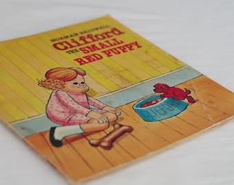Old childrens book. Vintage kids books - Clifford the Small Red Puppy. 1970s retro reading gift for child. Surreal whimsical story and art