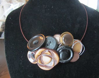 The Bronze necklace crafted from recycled buttons