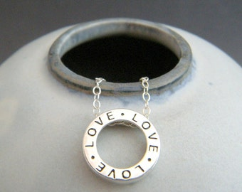 small sterling silver love necklace. word circle. round love charm. simple gift everyday every day pendant. dainty delicate. classic jewelry