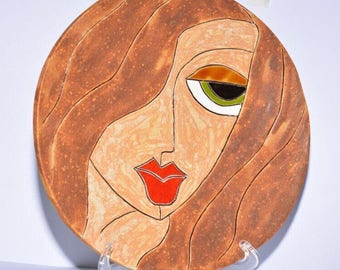 Woman face ceramic plate