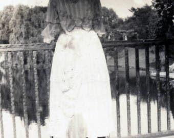 vintage photo 1917 big blouse Bow Woman from Back Looks Out over the Fence to Serene Water