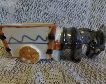 Vintage ceramic donkey with cart with The Truman's on side of cart