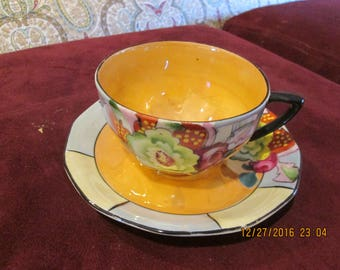 Set of 6 cups and saucers made in Japan, good condition, colorful design hand painted 1930's