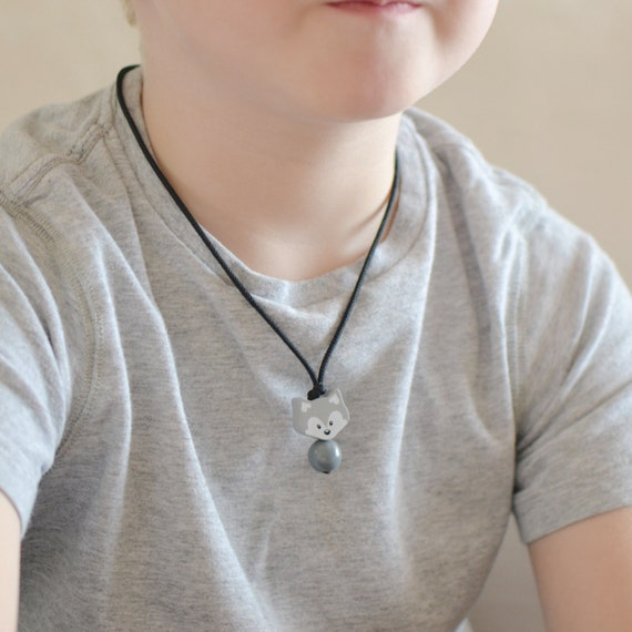 little boy with necklace en pendant and girl