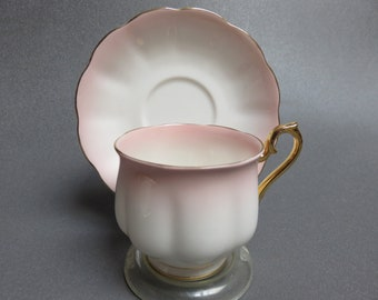 Royal Albert Pink from the Rainbow series cup and saucer Montrose shape