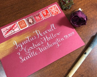Gold Highlight Calligraphy on Dark Envelope for Weddings and Special Occasions