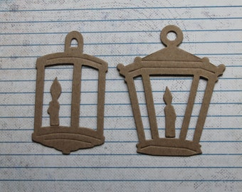 4 Bare chipboard lantern with candle die cuts 2 of each style 1 3/4 inches wide x 3