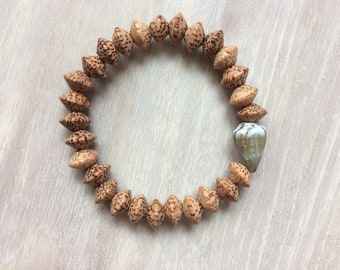 Seashell bracelet, stretchy bracelet with cone shell and palm wood beads, seashell jewelry, surfer bracelet