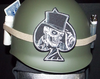 Military Army helmet liner, full leather liner-strap, size adjustable,Ace of spades patch,rifle oil under helmet band,playing card, lighter.