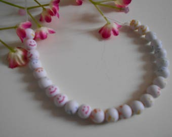 25 beads white with multicolored smile smile x
