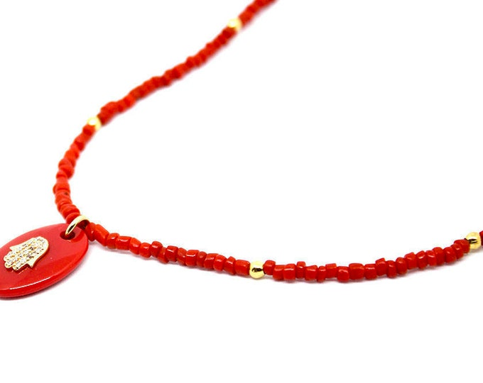 the Choker in coral with a Hamsa pendant