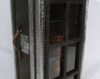 Trunk of a swiss officer transformed into cabinet