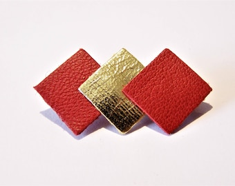 Pin 3 squares of red and gold leather