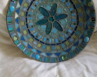 Artisan bamboo bowl lined with glass pebbles, stained glass and mosaic tiles set with a glass flower in the centre.