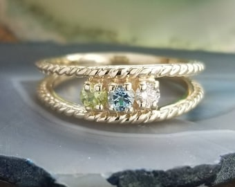 10k yellow gold mothers ring with 3 genuine stones