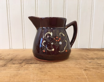 Small Brown Stoneware Pitcher with hand painted design creamer