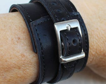 black leather strap. wrist strength; Bracelet of strength; black leather bracelet.