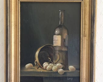 Grapes and gold vessel still life