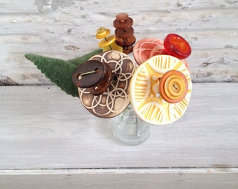 red, yellow and  brown button flower bottle bouquet