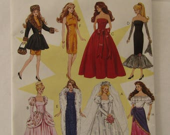 "Vintage 1996 McCall's pattern #8552  Fashion Doll Wardrobe includes eight outfits for Barbie-type dolls standing 11 1/2"" tall"