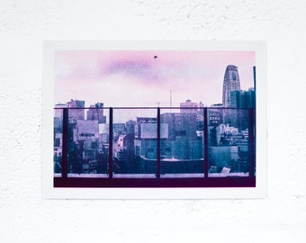 Soar - Risograph Printed duochrome photograph of Shibuya, Japan and a bird.  Teal and Fluorescent Pink riso A4 print.
