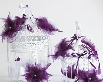 Holder and with purple flowers wedding urn cages beads and ribbons