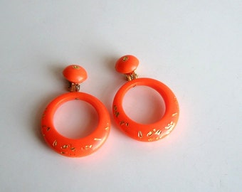 orange hoop earrings . 1960s clip on earrings . neon orange hoops . vintage clip ons in dayglo orange . 60s mod jewelry . new wave