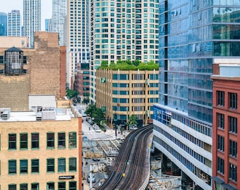 View of an L train and buildings in River North, Chicago, Illinois. Photo Print, Metal, Canvas, Framed.