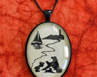 AFTERNOON READING on the BEACH Necklace, pendant on chain - Silhouette Jewelry