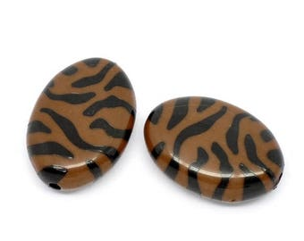 Two large oval beads acrylic Brown and black zebra.