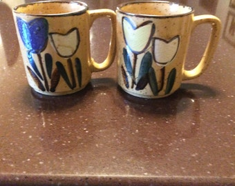 Set of 4 vintage speckled stoneware mugs with hand painted tulip design
