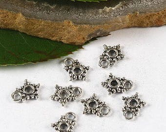 20 charms in antique silver stars