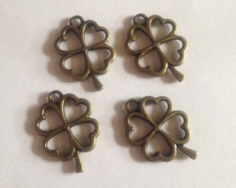 Four Brass Clover Charms