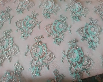Vintage Light Blue Lace with Metallic Silver Highlights On a White See Through Netting Background,  Floral Design Lace, Inv.#901