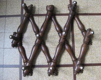 French wooden accordion coat rack with 10 knobs.