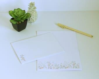 Floral border stationery set.