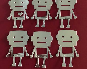 Six little silver robot die cuts with tiny hearts