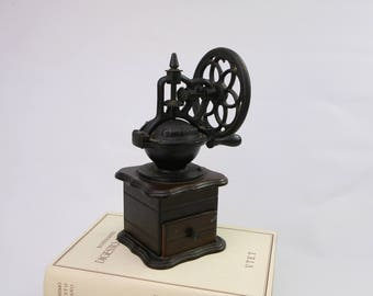 Vintage wooden and cast iron coffee grinder