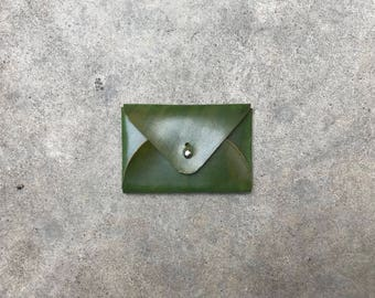 The flapjack leather wallet in hand dyed green