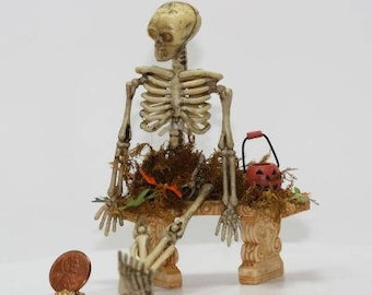 Dollhouse Miniature Halloween Lonely Skeleton on an Outdoor Bench