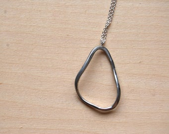 Necklace with organic shape pendant.