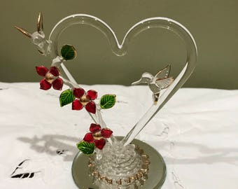 """Heart Shaped Hand Blown Glass Ornament With Red Flowers And Two Hummingbirds On Each Side Of Heart* Sits On Mirror Stan* 5"""" T X 4"""" W*"""