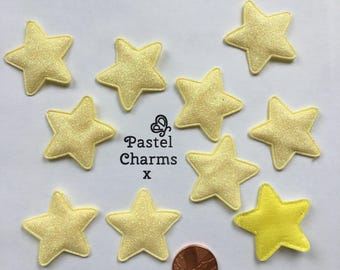 Pack of 10 yellow glitter star embellishments
