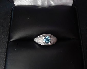 Sterling silver Esposito childrens light blue stone.Could be used as birthstone March.