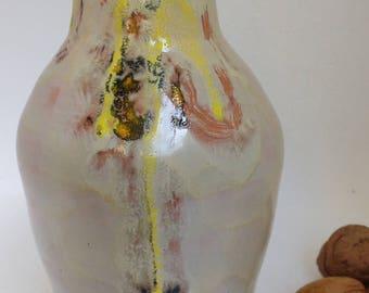 Glazed vase. Red mud. Handmade around Potter. Keeps water.