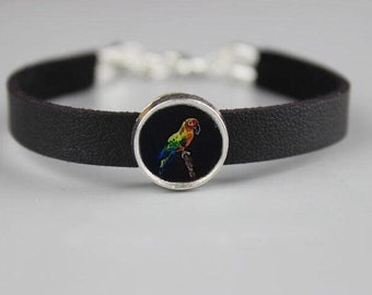 Hand painted micro painting of sun conure parrot on leather bracelet