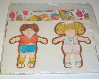 1984 Cabbage patch paper dolls gift Wrapping paper Never Opened with outfits