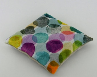 Lavender pillow, with large colorful dots fabric