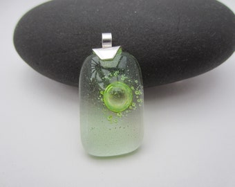 green bubble glass pendant set on silver bail