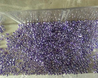 Approximately 2 mm sea blue purple seed beads